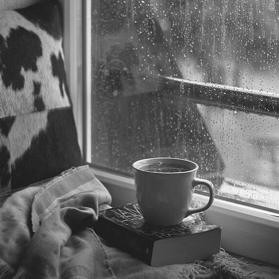 A warm cup of coffee and a book